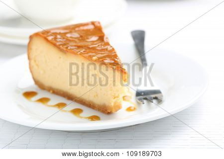 Fresh And Tasty Caramel Cheesecake On White Plate
