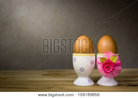 Eggcup And Boiled Egg, On Wooden Table.