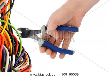 Hand with pliers and cable isolated on white background