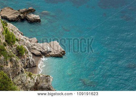 Small Cove And Turquoise Sea On Amalfi Coast In Italy