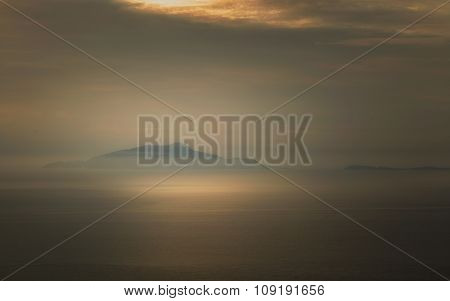 Mist Surrounds The Italian Islands Of Isola D'ischia And Procida