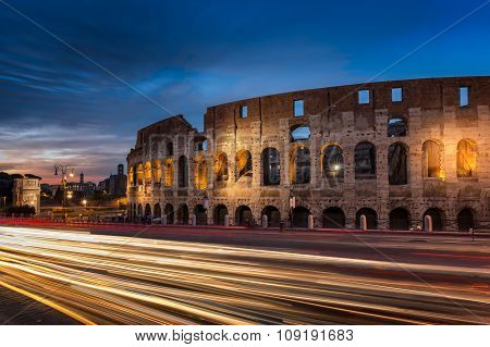Light Trails Pass The Colosseum In Rome At Dusk