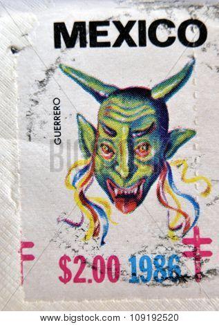 MEXICO - CIRCA 1986: A stamp printed in Mexico shows Mexican mask guerrero circa 1986