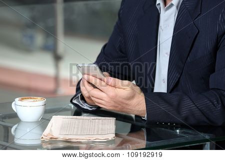 Businessman having lunch and working in a cafe