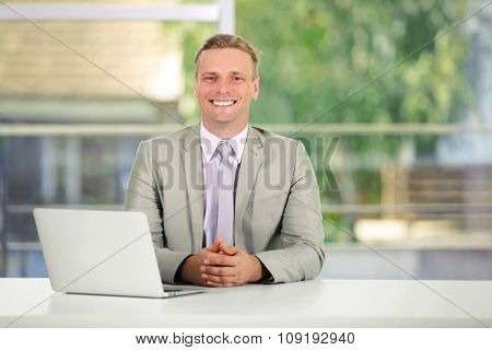 Young man working with laptop in the office
