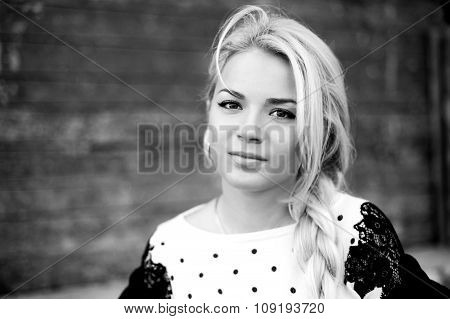 Black and White portrait of  beautiful woman with blond hair in a sweater outdoors