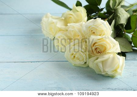 Bouquet Of White Roses On Blue Wooden Background