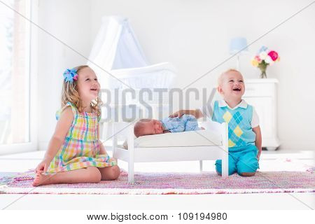 Little Boy And Girl Meet New Sibling