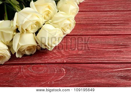 Bouquet Of White Roses On Red Wooden Background