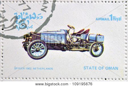 OMAN - CIRCA 1977: A stamp printed in State of Oman shows a old car Spyker 1902 Netherlands