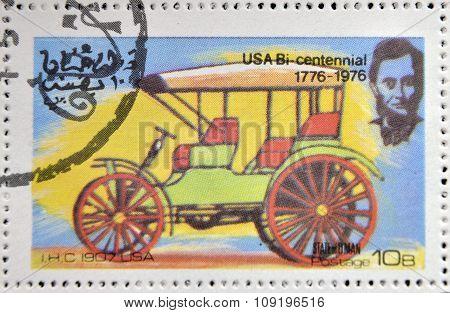 OMAN - CIRCA 1976: A stamp printed in State of Oman shows a american car I.H.C. 1907 usa circa 1976