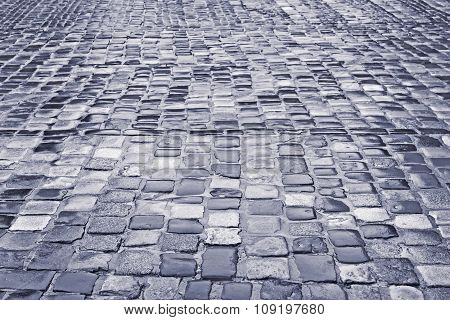 Road With Wet Cobblestones In Rainy Weather