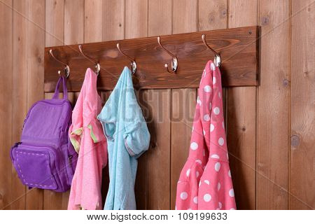Children things hanging on wall in room
