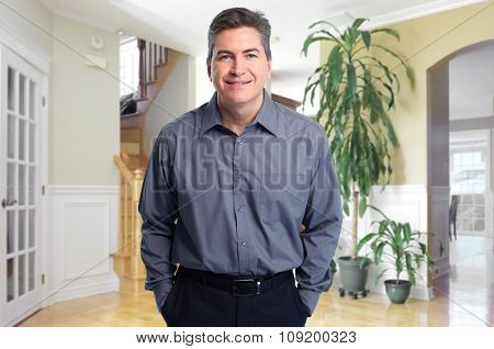 Smiling Real estate agent man at new house.