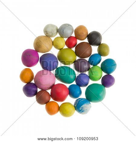 Plasticine, colorful balls made by hand. Isolated on the white background
