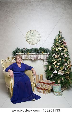Pensioner woman at Christmas tree. New Year content