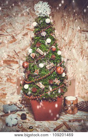 New year decorations. Christmas tree, cinnamon, box, snow.  toning photo.