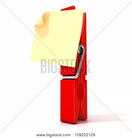 Red clothes pin with sticky note