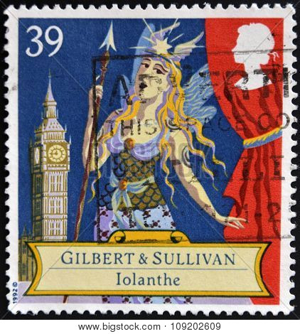 a stamp printed in the Great Britain shows Scene from comic opera Iolanthe by Gilbert and Sullivan