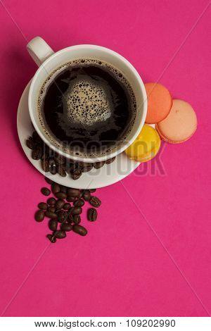 Cup Of Coffee With Macaroons And Coffee Beans
