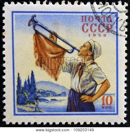 USSR - CIRCA 1958: A stamp printed in USSR shows image of Pionier with trumpet circa 1958.