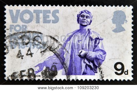 stamp printed in Great Britain dedicated to Granting of votes to women shows Mrs. Emmeline Pankhurst