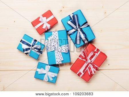 gift boxes with ribbon bows on wood