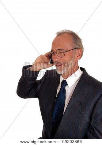 Happy Businessman On Cell Phone.
