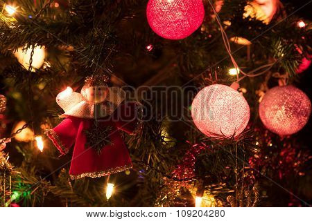 Angel And A Decorated Christmas Tree With Light