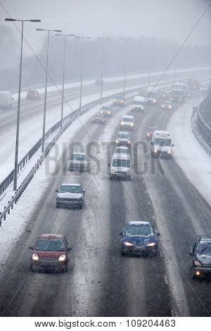 Traffic On Motorway During Snowstorm