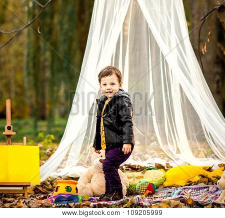 Happy Little Boy Playing Outdoor In The Park