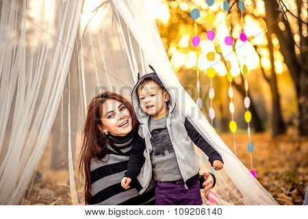 Happy Mother And Her Little Son Playing In The Park