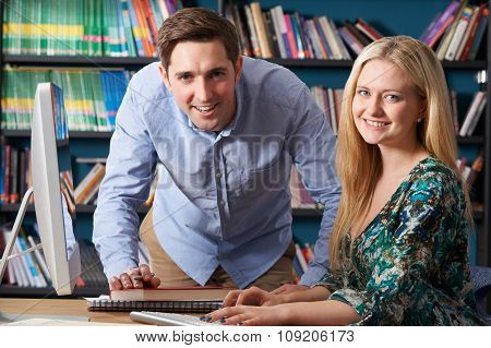 Teacher Working With Teenage Pupil At Computer