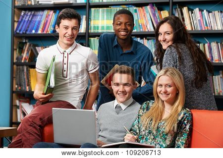Portrait Of Happy Students In Library