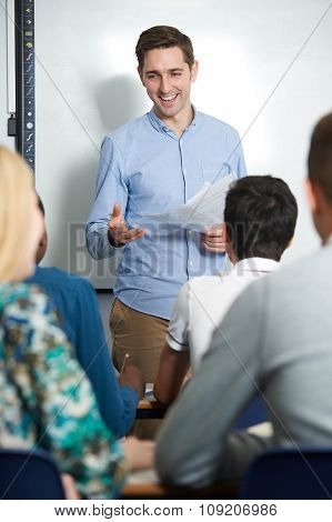 Teacher Talking To Pupils In Class