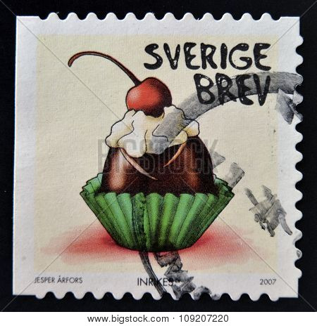 SWEDEN - CIRCA 2007: stamp printed in Sweden shows Chocolate bonbon with whipped cream and cherry