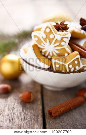 Cookies with spices and Christmas decor, on wooden table