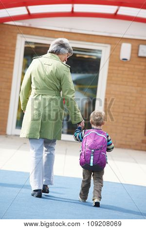 Grandmother Taking Grandson To School