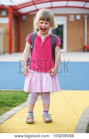 Little Crying Girl Standing Outside Pre School Building