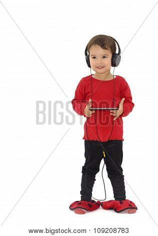 Little Girl Listening Music With Headphones, Isolated On White