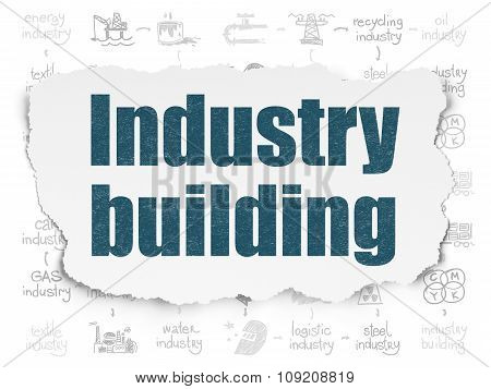 Industry concept: Industry Building on Torn Paper background