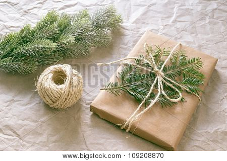 Christmas Gift And Fir Tree Branch