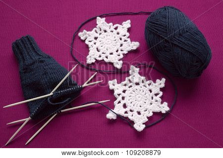 Process Of Knitting Mittens On The Needles