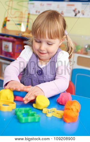 Female Pre School Pupil Playing With Modelling Clay
