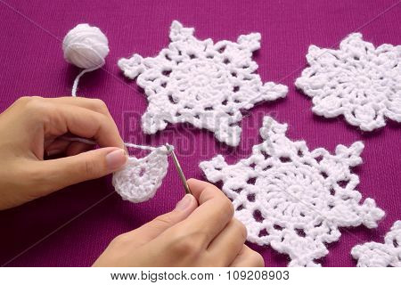 Woman Knits Crochet Christmas Decoration - Snowflakes