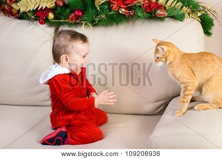 Baby Girl And Red Cat