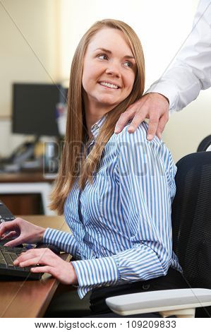 Businessman And Businesswoman Having Affair In Office