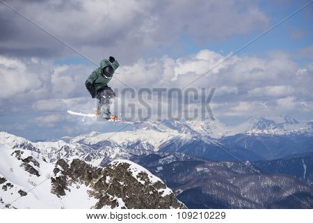 Flying skier on mountains, winter extreme sport
