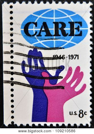 UNITED STATES OF AMERICA - CIRCA 1971: A Stamp printed in USA shows the Hands reaching for Care