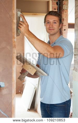 Plasterer Working On Wall